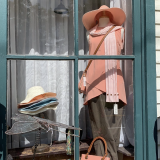 Window display with clothing and hat